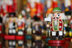 Christmas Nutcracker in front of Collection of Toy Soldiers Royalty Free Stock Photography