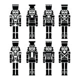 Christmas nutcracker - soldier figurine black icons set. Vector icons set of Xmas nutcrackers statues isolated on white Stock Image