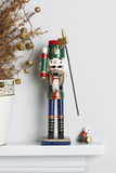 Christmas Nutcracker Solider Broken With Dead Pine Tree Stock Photos