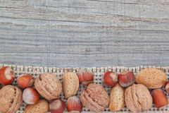Christmas nuts on sackcloth. Royalty Free Stock Photo