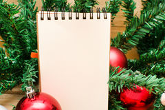 Christmas object and notebook Royalty Free Stock Photos