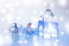 Christmas Objects. Two snowmen beside crystal church isolated on white background Royalty Free Stock Image