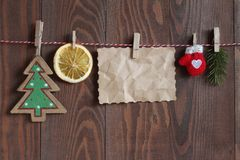 Free Christmas Objects On A String On Clothespegs On The Wooden Background Royalty Free Stock Photography - 104775477
