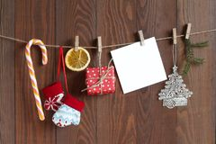 Christmas objects and white cart for wishes on the clothespins.  royalty free stock photo