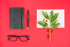 Christmas office desktop greetings card, red background Stock Photo