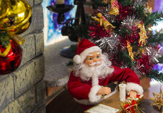 Christmas office of Santa Claus ornaments on the mantelpiece Stock Images