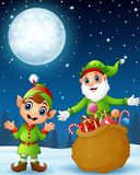 Christmas old elf with cartoon elf kid present a sack full of gifts Royalty Free Stock Photos