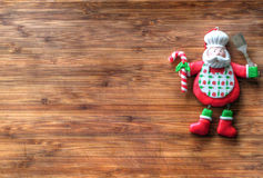 Christmas - old wooden background and funny chef Santa Claus Stock Photo