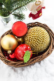 Christmas сomposition with christmas decorations in basket and Royalty Free Stock Photos