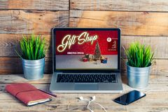Gift shop, Christmas Special, in a laptop screen at the office. Royalty Free Stock Image