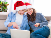 Christmas Online Shopping. Couple Using Credit Card to E-Shop royalty free stock photography