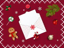 Christmas open envelope with empty sheet,. Fir tree branch, gold and red bubbles, candies, gingerbread man, holy, candle on red knitted background. Vector wish Stock Images