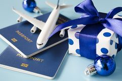 Free Christmas Or New Year Travel Concept. Toy Airplane With Passports And Gift Box On Blue Background Royalty Free Stock Photo - 163476655