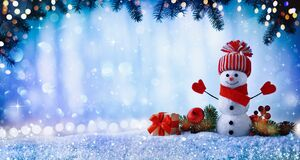 Free Christmas Or Winter Background With With Funny Snowman, Gift Box And Fir Tree Branches In Wintery Scenery. Fairy Holiday Card Royalty Free Stock Photos - 198834988