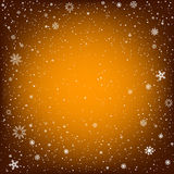 Christmas orange background with snow Stock Image