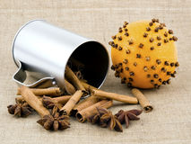 Christmas orange with cloves on linen background Stock Photo