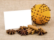 Christmas orange, spices and white note card Stock Photography
