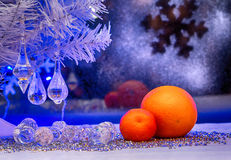 Christmas, orange, wallpaper. Photo in old image style. Mandarin, orange on the background of the winter window. Christmas holiday. blue backlight, photo in old Stock Photo