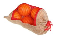 Christmas oranges in a rustic canvas homemade bag isolated stock image