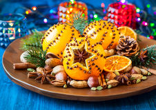 Christmas oranges,spices and nuts Stock Photos
