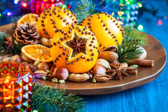 Christmas oranges,spices and nuts Stock Images