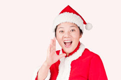 Christmas Oriental woman gestures. A Christmas Oriental woman gestures Stock Images