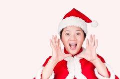 Christmas Oriental woman gestures. A Christmas Oriental woman gestures Royalty Free Stock Photography