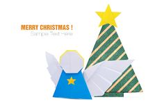 Christmas origami angel decorations in paper on a white background royalty free stock image