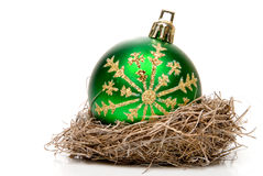 Christmas Ornament. A Christmas ornament in a birds nest stock images