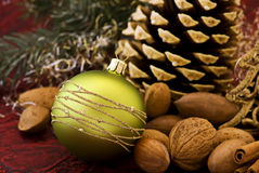 Christmas Ornament. And nuts as closeup on red background stock photo