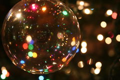 Christmas Ornament. Shot of clear ornament on Christmas tree, with lights in the background Royalty Free Stock Photos
