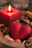 Christmas Ornament. With candle light and nuts as closeup royalty free stock image