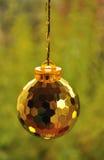 Christmas ornament. Christmas ball on the green background Stock Photography