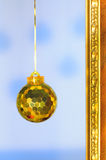 Christmas ornament. Christmas ball and part of the golden frame Stock Photo
