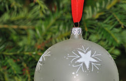 Christmas ornament. Christmas ball hanging on a red ribbon Royalty Free Stock Photo