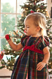 The Christmas Ornament. Little Girl Spinning A Christmas Ornament Stock Images