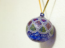 Christmas ornament. Isolated christmas ornament lying on white wall Royalty Free Stock Photos