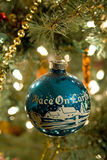 Christmas ornament. A vertical picture of a blue and white antique Christmas ornament that has the picture of a farm scene in white with the words 'Peace On royalty free stock photos