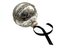 Christmas Ornament. Isolated silver ornament with glitter and worn black ribbon Royalty Free Stock Photography
