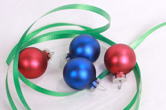 Christmas ornament 2. Two blue and two red christmas ornaments with green ribbon royalty free stock images