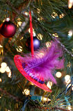 Christmas ornament. Red hat club Christmas ornament - red hat with purple feather Stock Photography
