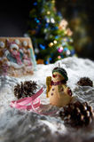 Christmas Ornament. On snow with christmas tree background stock images
