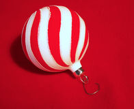 Christmas ornament. Red and white swirled christmas ornament Stock Images