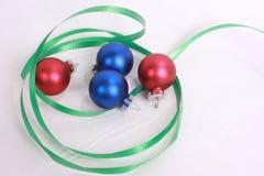 Christmas ornament 3. Two blue christmas ornaments on fir tree stock photo