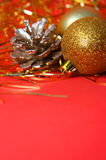 Christmas ornament. Gold balls and red background Stock Photography