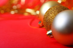Christmas ornament. Gold balls and red background Royalty Free Stock Image