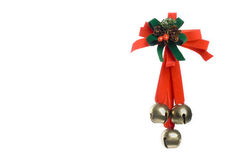 Christmas ornament. Woth berry, bow and three jingling bells Royalty Free Stock Photography