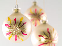 Christmas Ornament. Three Christmas balls hanging.  Shallow depth of field Stock Images