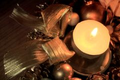 Christmas ornament. Candle and Christmas decorations giving ideas for a Christmas card Royalty Free Stock Images
