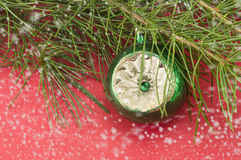 Christmas ornament ball with a fir tree and snowflakes Royalty Free Stock Photo